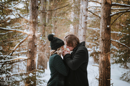 Newmarket, ON Fine Art Engagement Session during a winter Proposal in the snow under the trees