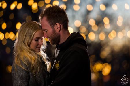 Fort Collins Fine Art Pre Wedding Portrait for a Couple under the lights in Old Town