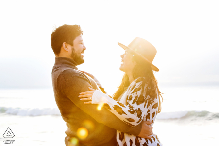 Sunset Cliffs Artful Engagement Picture in San Diego, CA with the beach and waves in the background