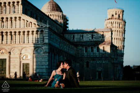 Piazza dei Miracoli Pre Wedding Photoshoot w Fine Art Style at the the location of Piazza dei Miracoli with the background of the Leaning Tower was perfect for a kiss
