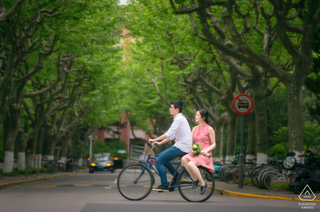 Fudan University, Shanghai Fine Art Engagement Session while The couple were riding a bicycle in campus