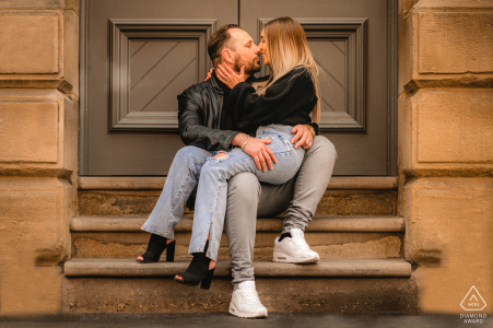 Manchester City Centre portrait e-session of couple sitting on the stairway to a door