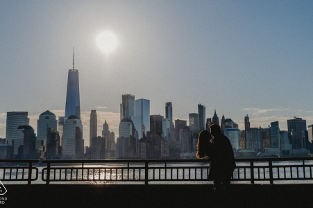 Liberty State Park environmental engagement e-session for a silhouetted image of couple and NYC skyline in background
