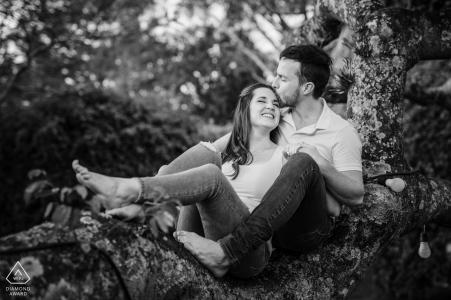 True Love pre wedding Photoshoot at the Hacienda Villa Hermosa in La Garita, Alajuela, Costa Rica of a Couple having fun under a tree during their BW engagement session