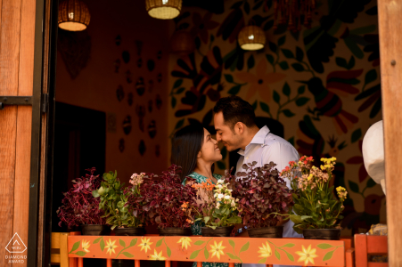 True Love Engagement Portrait Session at the Restaurante Mama Mia in San Miguel de Allende displaying a couple as they enter the restaurant, and the photo was taken from the outside to the inside of the restaurant with a small direction towards the couple