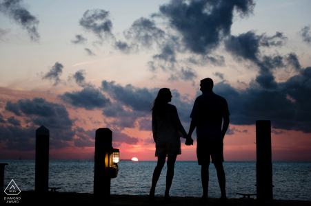 Sunset Key couple e-shoot in Key West, Florida silhouetted at dusk on a dock