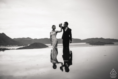 HK couple e-session at the Pavilion of Harmony, The Chinese University of Hong Kong with a pond reflection of the dancing couple