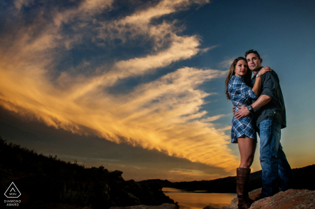 Horsetooth Reservoir couple e-shoot in Fort Collins, Colorado while looking on a beautiful sunset
