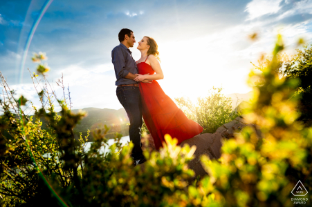 Fort Collins couple poses for a portrait at Horsetooth Reservoir during their engagement session