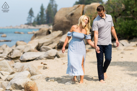 Nevada bride and groom to be, modeling for a Zephyr Cove pre-wedding picture during a walk on the beach