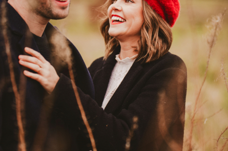 Outdoor Wanstead Flats, London couple engagement photography portrait showing the Girl smiling at her husband to be after he cracked a joke