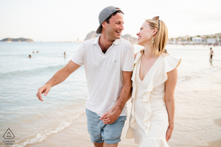 Plage de La Ciotat outside environmental couple prewedding photoshootwhile walking on the beach sand