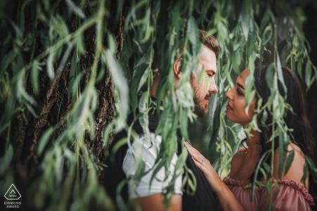 Szeged, Hungary environmental couple pre wedding image sessionin the hanging tree leaves