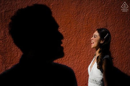 On location Perth couple engagement session for A creative portrait at sunset against a red stucco wall