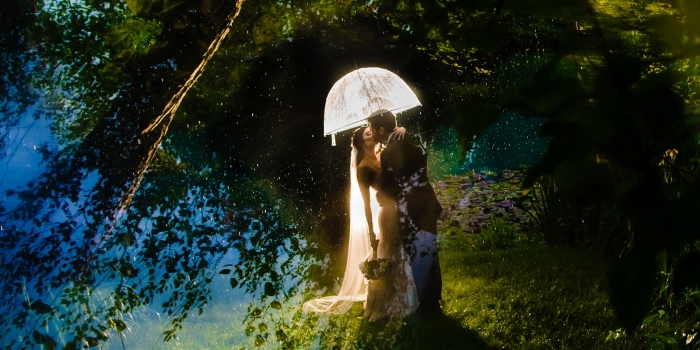 Fine Art Bride and groom portrait on wedding day at the water with an umbrella