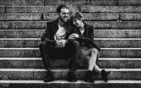 France wedding engagement photograph of couple sitting on stairs in black and white