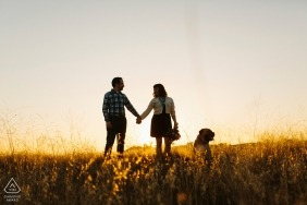CA sunset engagement portrait session in the grass field with a dog