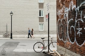 Urban wedding engagement photo with graffiti walls in Montreal by Quebec engagement photographers