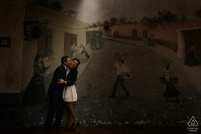 Lima prewedding portrait of a couple with a mural as their backdrop | Peru wedding engagement