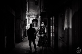 Czech Republic Alley creates a moody feel to this Black and white engagement portrait