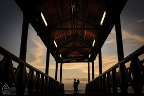 Lima, Peru Engagement Photographer. At the end of the dock, silhouetted at sunset. Pre-wedding portrait photography.