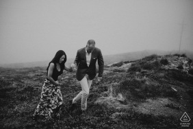 Northern California Engagement Photographer. Black and white portraits of a couple walking the hills holding hands.