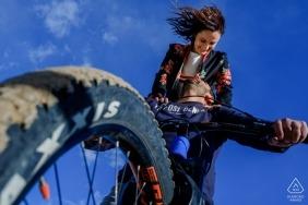 Creative wedding engagement portrait of couple on a mountain bike | Alicante prewedding photography