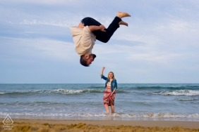 Valencia pre-wedding portrait Photographer. She walks in the water at the beach as he flips head over heels for her.