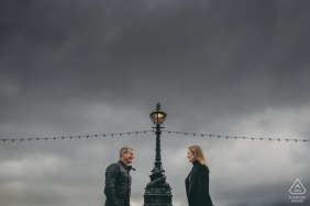 Portrait of a couple, positioned one on each side of a lamppost | Southbank wedding engagement photography
