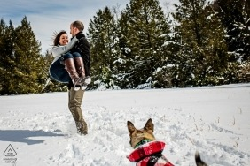 Baltimore wedding engagement pictures in the snow with a dog by a MD photographer