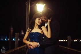 Rome evening couple prewed portrait under a street lamp at night