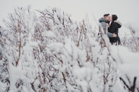 DC Engagement Photography in the Winter Snow with Kissing Couple