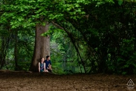 A huge solid tree sits behind this engaged couple for their pre-wedding shoot in Austin