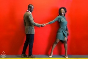 Pre Wedding London Engagement Photography | Red painted wall for background in this bold portrait