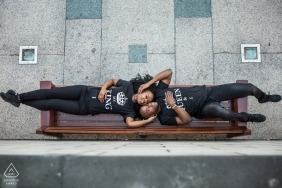 London Engagement Photographer | Overhead portrait of couple lying on a public bench