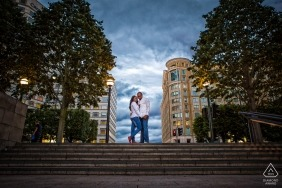 Symmetrical England pre-wedding Love shoot | engagement portrait of a couple standing at the top of concrete stairs