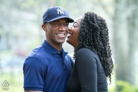 Atlanta couple portraits with the groom to be wearing a New York baseball cap during their engagement photo session