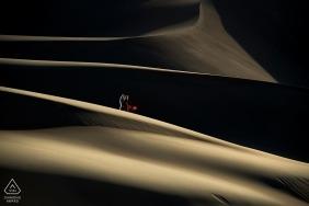 Sand dunes pre-wedding engagement session - Desert couple portrait