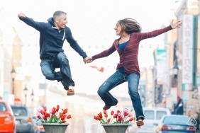 Pre Wedding Seattle portrait session with a jumping couple in the streets