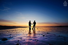 Channel Islands Sunset portrait - engagement photograph of a couple silhouetted at the colorful beach