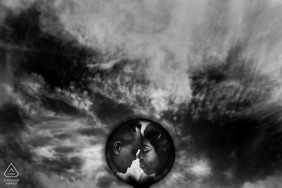 Turkey couple reflected in small round mirror against the sky - Black and white engagement photography