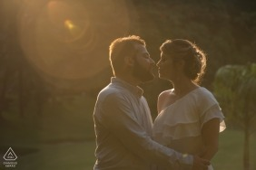 Lens flare in the warm sun in Rio de Janeiro provide us with a dramatic engagement portrait