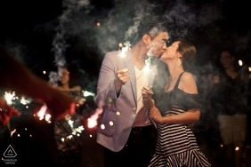 Malaysia pre-wedding portrait of a couple holding sparklers at night