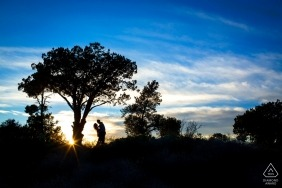 Arizona sunset provide this couple with a bold engagement portrait silhouetted in black and blue