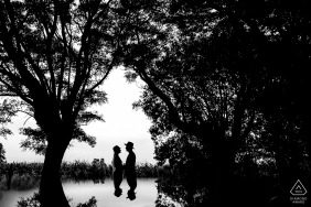 Silhouettes and mirrored effects Bring this black-and-white engagement portrait to life