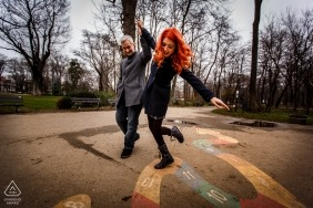București Engagement Photographer | Romania Couple Walking and Playing Together