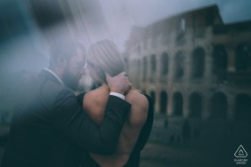 NYC misty and moody portrait from behind of engaged couple