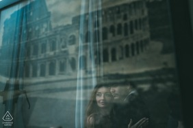 New York City couple reflected in the glass of Wall art for their pre-wedding portraits