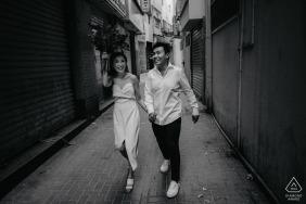 Dubai Wedding Photographer shooting in alley with couple walking