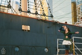 Boston, Massachusetts Engagement Portrait with Couple and Tall Ships